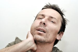 man with swollen face from tooth has blurred vision with headaches